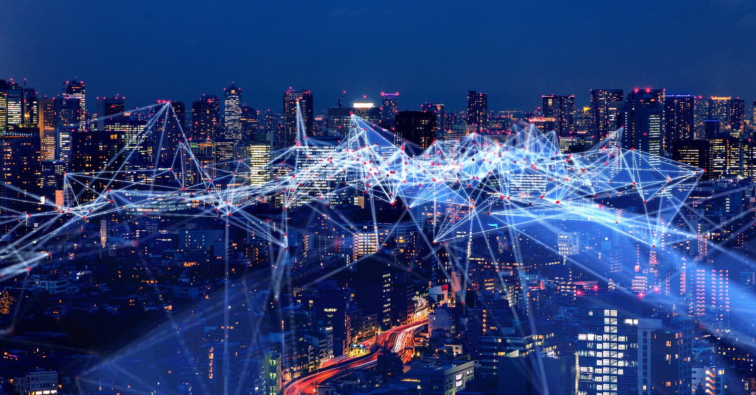 Photo of big city at night with lights and connection layers over it